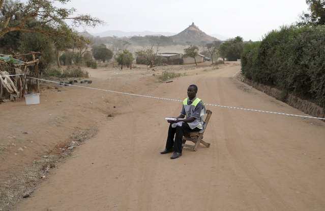 An electoral commission worker sits in a polling station just before people start voting during elections in Kaabong in Karamoja region, Uganda February 18, 2016. (Photo by Goran Tomasevic/Reuters)