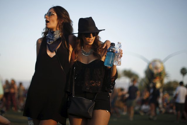 Women dance to Hozier at the Coachella Valley Music and Arts Festival in Indio, California April 11, 2015. (Photo by Lucy Nicholson/Reuters)