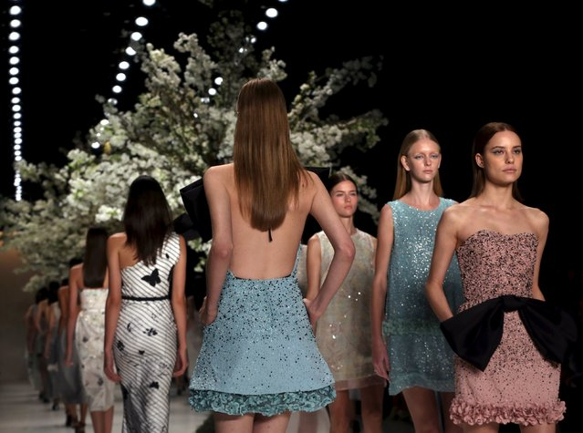 Models appear on the catwalk at the end of Acquastudio Summer 2016 Ready To Wear collection show during Sao Paulo Fashion Week in Sao Paulo April 16, 2015. (Photo by Paulo Whitaker/Reuters)