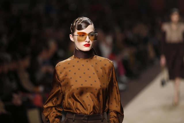 A model wears a creation as part of the Fendi women's Fall-Winter 2019-2020 collection, that was presented in Milan, Italy, Thursday, February 21, 2019. (Photo by Antonio Calanni/AP Photo)