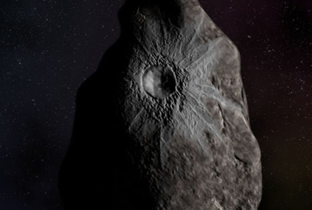Image taken from Hubble space telescope shows a crater on an object called 8405 Asbolus, a 48 mile-wide chuck of ice and dust that lies between Saturn and Uranus. Astronomers using the telescope found what looks like a fresh water crater less than 10 million years old, exposing underlying ice that is apparently unlike any yet seen. (Photo by Reuters/NASA)
