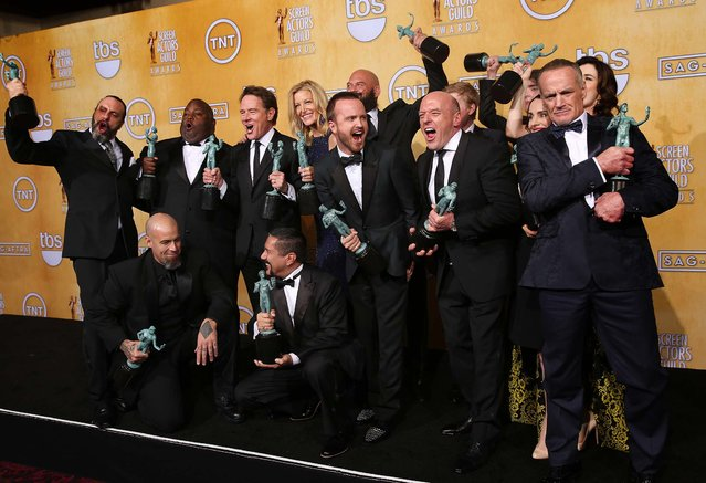 """The cast of """"Breaking Bad"""" pose in the press room with their awards for Outstanding Performance by an Ensemble in a Drama Series. (Photo by Matt Sayles/Invision)"""