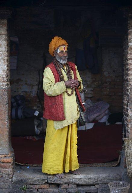 A Hindu holy man, or sadhu, stands at the entrance of an ashram during the Shivaratri festival at the premises of Pashupatinath Temple in Kathmandu, Nepal, March 7, 2016. (Photo by Navesh Chitrakar/Reuters)