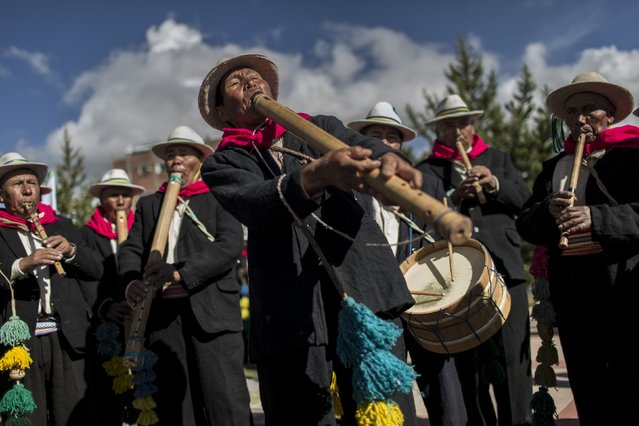 In this January 29, 2017 photo, musicians perform for dancers on the shores of Lake Titicaca, as they practice before their presentation for the Virgin of Candelaria celebrations in Puno, Peru. Dancers in colorful masks and elaborate costume celebrate the Virgin of Candelaria, patron saint of communities along the shore of Lake Titicaca, in what's considered the largest Catholic festival in the Andes. (Photo by Rodrigo Abd/AP Photo)