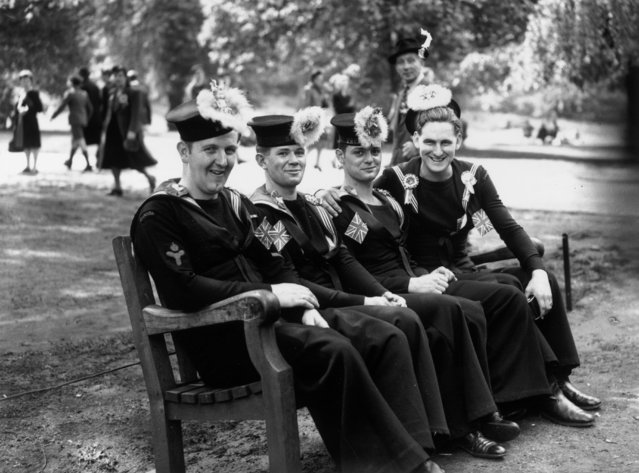 8th May 1945: Canadian sailors resting in the park during celebrations in London on VE Day. (Photo by Keystone/Getty Images)
