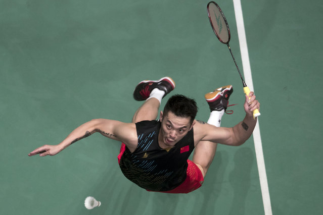 In this April 7, 2019, photo, China's Lin Dan returns a shot during Men's single final match against China's Chen Long at the Malaysia Badminton Open in Kuala Lumpur, Malaysia. (Photo by Vincent Thian/AP Photo)