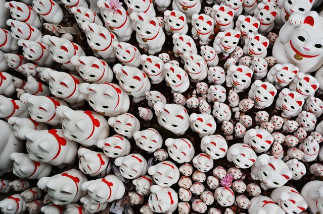 """Statuettes of cats called """"maneki neko"""" in Japanese (beckoning cat) are pictured at Gotokuji temple in Setagaya Ward in Tokyo on April 25, 2019. (Photo by Charly Triballeau/AFP Photo)"""