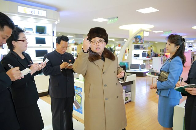North Korean leader Kim Jong Un, together with his wife Ri Sol Ju (R), gives field guidance at the newly built Mirae Shop and Health Complex in this undated photo released by North Korea's Korean Central News Agency (KCNA) on March 28, 2016. (Photo by Reuters/KCNA)