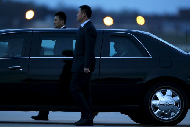 Security agents walk alongside Chinese President Xi Jinping's (silhouetted, 2nd R in window) car as he arrives to attend the upcoming Nuclear Security Summit meetings in Washington, on the tarmac at Joint Base Andrews, Maryland March 30, 2016. (Photo by Jonathan Ernst/Reuters)