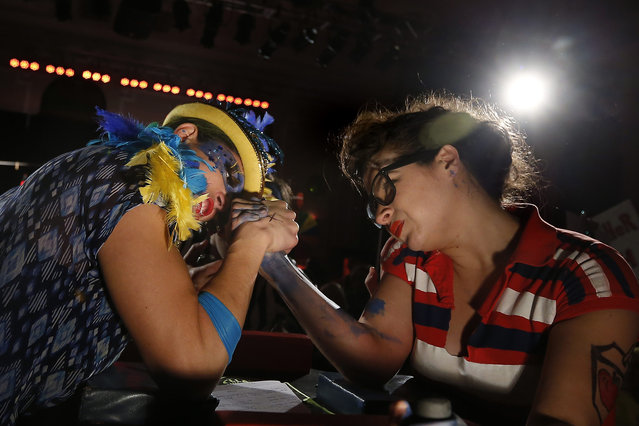 Emilia Garcia (L) competes against Avery Ferguson at the Chicago League of Lady Arm Wrestlers event in Chicago, March 9, 2014. The event was put on to raise money for the Sideshow Theatre Company and for charity. (Photo by Jim Young/Reuters)