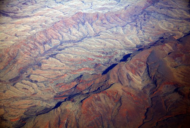 A general view of dried-up river beds and hills in the Pilbara region of Western Australia December 2, 2013. (Photo by David Gray/Reuters)
