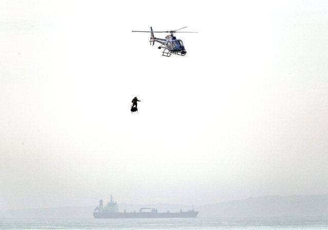French inventor Franky Zapata prepares to land near St. Margaret's beach, Dover Sunday, August 4, 2019. Zapata has successfully flown over the English Channel on a personal flying machine. (Photo by Steve Parsons/PA Wire via AP Photo)