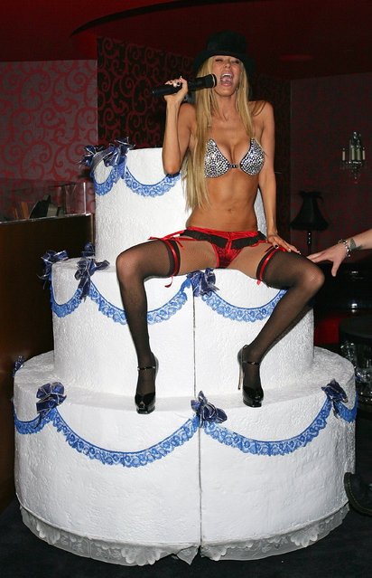 "Former adult film actress Jenna Jameson sings ""Happy Birthday"" to her boyfriend, mixed martial arts fighter Tito Ortiz, as she hosts his birthday party at the CatHouse at the Luxor Resort & Casino early  January 26, 2008 in Las Vegas, Nevada. Ortiz turned 33 on January 23rd.  (Photo by Ethan Miller/Getty Images)"