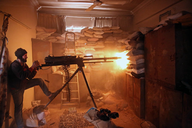 An opposition fighter from the Failaq al-Rahman brigade fires a heavy machine gun in Jobar, a rebel-held district on the eastern outskirts of the Syrian capital Damascus, on March 19, 2017. (Photo by Amer Almohibany/AFP Photo)