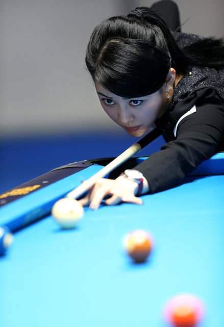 Pan Xiaoting of China competes during the first day match against Jennifer Barretta of the United States at the 2013 Amway eSpring Women's World 9-Ball Open in Taipei, southeast China's Taiwan, March 14, 2013. (Photo by Xie Xiudong/Xinhua)