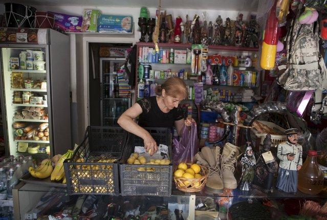An employee works at a shop in Leningori (or Akhalgori), in the breakaway region of South Ossetia, Georgia, July 6, 2015. (Photo by Kazbek Basaev/Reuters)