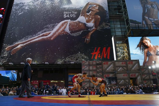 U.S. wrestler Jordan Oliver (L) wrestles Boris Novachkov of Bulgaria during the Beat the Streets international wrestling competition at Times Square in New York May 7, 2014. (Photo by Shannon Stapleton/Reuters)