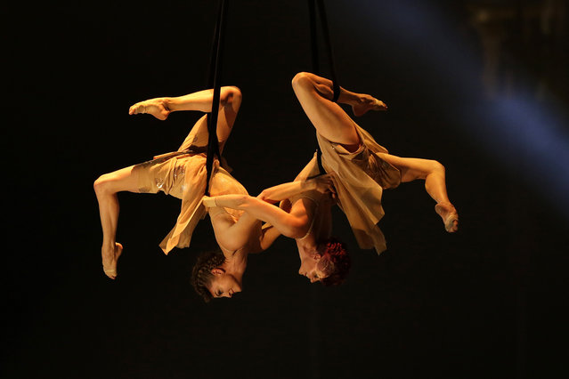 Cirque du Soleil acrobats perform during the opening ceremony of the 2015 Pan Am Games in Toronto, Friday, July 10, 2015. (Photo by Felipe Dana/AP Photo)
