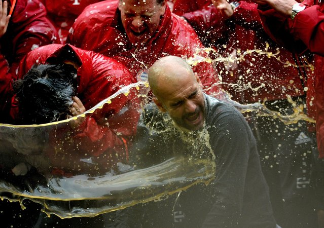 Munich coach Pep Guardiola gets showered in beer after the German Bundesliga soccer match between FC Bayern Munich and Hanover 96 at Allianz Arena in Munich, Germany, 14 May 2016. (Photo by Andreas Gebert/EPA)