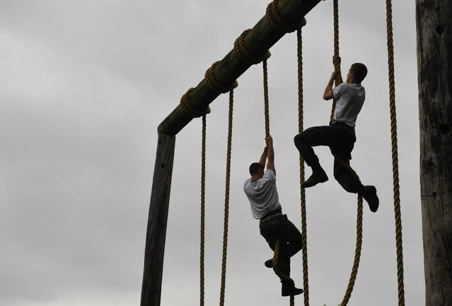 United States Naval Academy plebes take part in an obstacle course during Sea Trials at the United States Naval Academy on Tuesday May 17, 2016 in Annapolis, MD. (Photo by Matt McClain/The Washington Post)