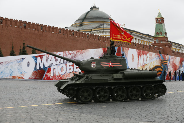 Russian soldiers drive famous WWII tank T-34 along Red Square during the Victory Day military parade to celebrate 72 years since the end of WWII and the defeat of Nazi Germany, in Moscow, Russia, on Tuesday, May 9, 2017. (Photo by Alexander Zemlianichenko/AP Photo)