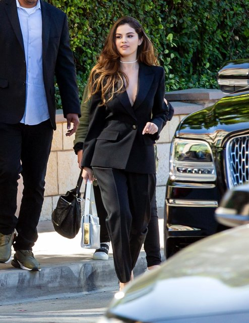 Singer-actress Selena Gomez puts on a very s*xy and sophisticated display in a black suit with no bra and chic handbag as she heads to a business meeting at Burbank Studios in Burbank, California on October 23, 2019. (Photo by Backgrid USA)