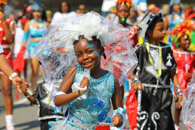 Children perform at the Notting Hill Carnival in London, Britain, 25 August 2019. The Notting Hill Carnival is the largest street carnival in Europe, with more than a million people expected to attend the two-day celebration of Caribbean heritage on 25 and 26 August. (Photo by Vickie Flores/EPA/EFE)