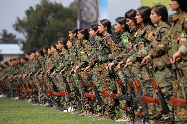 Kurdish female fighters of the Women's Protection Unit (YPJ) take part in a military parade as they celebrate victory over the Islamic state, in Qamishli, Syria on March 28, 2019. (Photo by Rodi Said/Reuters)