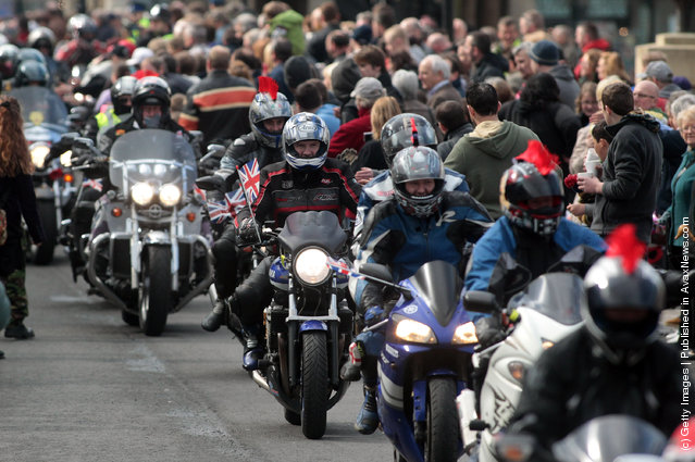 Bikers passes along the High Street on March 18, 2012 in Royal Wootton Bassett, England