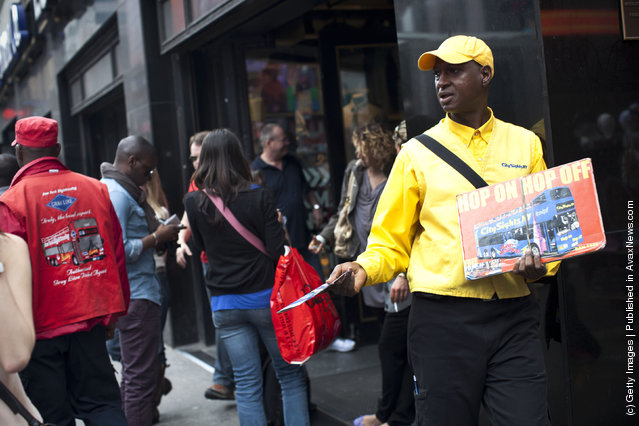 A City SightsNY worker hands out flyers to people in Times Square