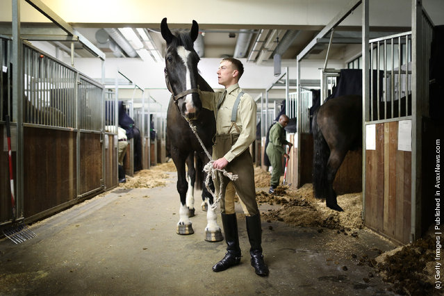 Trooper Lee Holland of The Household Cavalry Mounted Regiment (HCMR) stands with his horse Goliath at Hyde Park Barracks