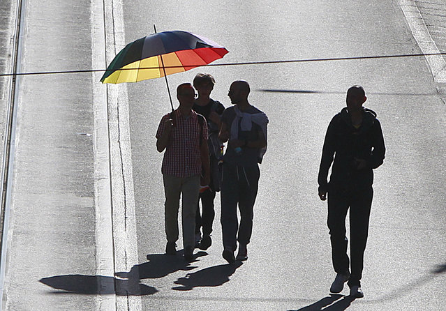 Warsaw residents with rainbow umbrella  walk in a colorful annual Equality Parade to show their support for sexual minority groups  in Warsaw, Poland, Saturday, June 11, 2016. (Photo by Czarek Sokolowski/AP Photo)