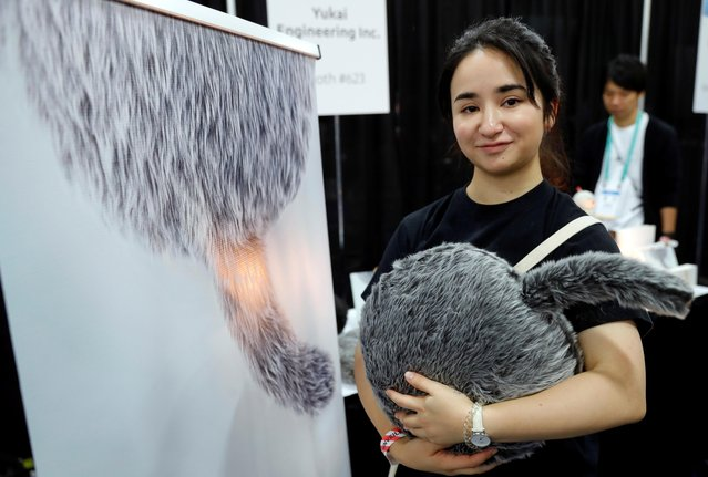 Saaya Okuda of Yukai Engineering, holds a Qoobo therapeutic robot, a cushion with a tail that moves the tail depending on how it's caressed, at CES Unveiled during the 2020 CES in Las Vegas, Nevada, U.S. January 5, 2020. (Photo by Steve Marcus/Reuters)