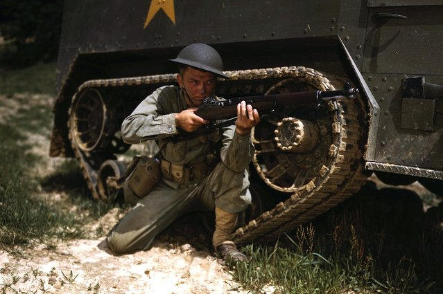 A young soldier of the armored forces holds and sights his Garand rifle like an old timer, at Fort Knox, Kentucky. He likes the piece for its fine firing qualities and its rugged, dependable mechanism. Photographed in June of 1942