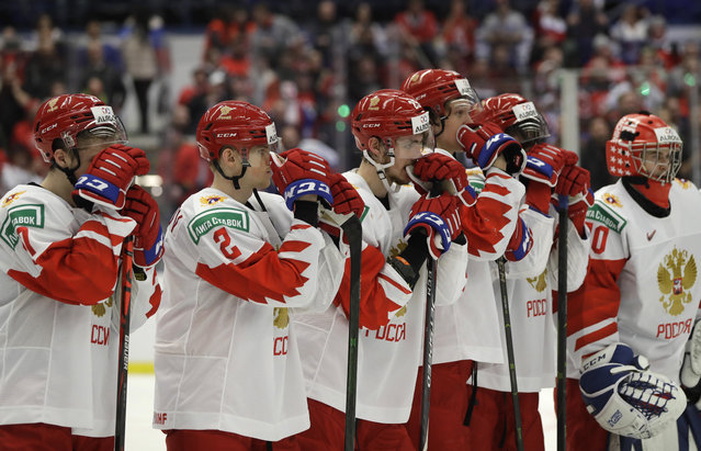 Russia's player stand on ice after loosing the U20 Ice Hockey Worlds gold medal match between Canada and Russia in Ostrava, Czech Republic, Sunday, January 5, 2020. (Photo by Petr David Josek/AP Photo)