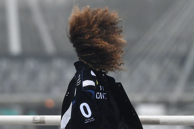 A woman's hair is blown by a gust of wind as she walks across Waterloo Bridge in London on January 14, 2020. Weather warnings issued yesterday by Britain's Met Office remained in force Tuesday after Storm Brendan brought winds of nearly 90mph to parts of the country. (Photo by Justin Tallis/AFP Photo)