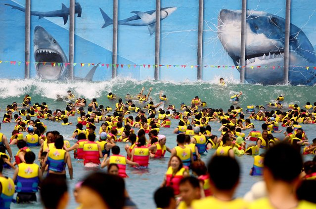 Huge crowds of people play at THEBES Happiness Water World during a continuous high temperature on July 5, 2014 in Shaanxi, Xi'an province of China. (Photo by ChinaFotoPress/ChinaFotoPress via Getty Images)