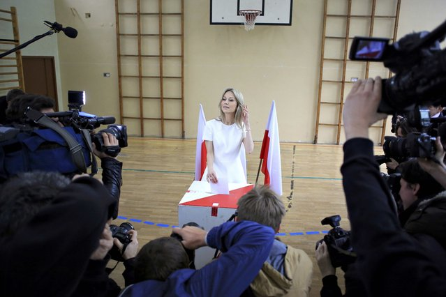 Presidential candidate Magdalena Ogorek is surrounded by media as she casts her vote in the first round of the Presidential election at a polling station in Warsaw, Poland May 10, 2015. (Photo by Jacek Marczewski/Reuters)