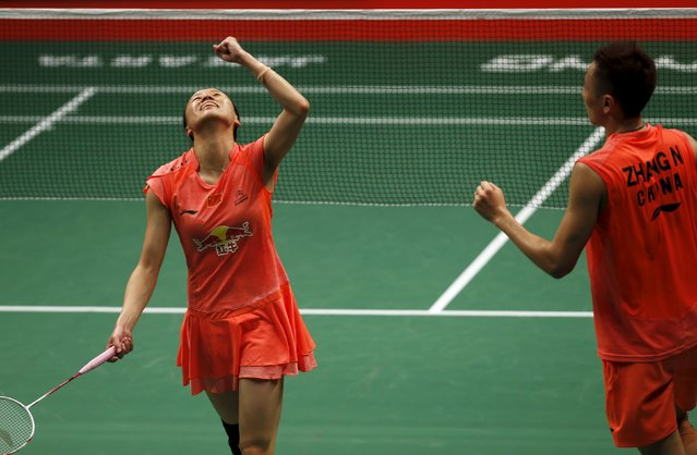 China's Zhao Yunlei and Zhang Nan react after beating compatriots Liu Cheng and Bao Yixin during  their mixed doubles badminton final match at the BWF World Championships in Jakarta, August 16, 2015. (Photo by Reuters/Beawiharta)