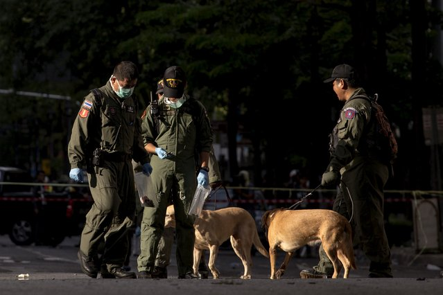 Experts investigate near the site of a deadly blast in central Bangkok, Thailand, August 18, 2015. (Photo by Athit Perawongmetha/Reuters)