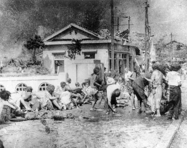 In this August 6, 1945, file photo, survivors of the first atomic bomb ever used in warfare are seen as they await emergency medical treatment in Hiroshima, Japan. The explosion instantly killed more than 60,000 people, with ten of thousands others dying later from effects of the radioactive fallout. (Photo by AP Photo)