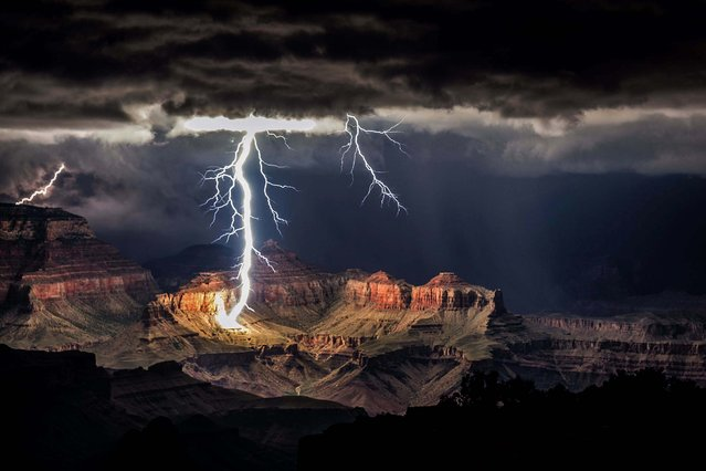 Honorable Mention, Pictorial. Photo by Rolf Maeder/Rex Features/ZumaPress.com):  A lightning storm over the Grand Canyon. (Photo by Rolf Maeder)