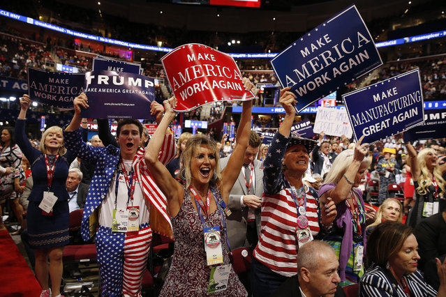 Delegates react to speeches on the second day of the 2016 Republican National Convention at Quicken Loans Arena in Cleveland, Ohio, USA, 19 July 2016. (Photo by Michael Reynolds/EPA)