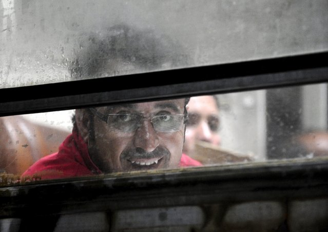 A migrant looks out from the window of a train near the border with Greece in Macedonia, August 31, 2015. (Photo by Ognen Teofilovski/Reuters)