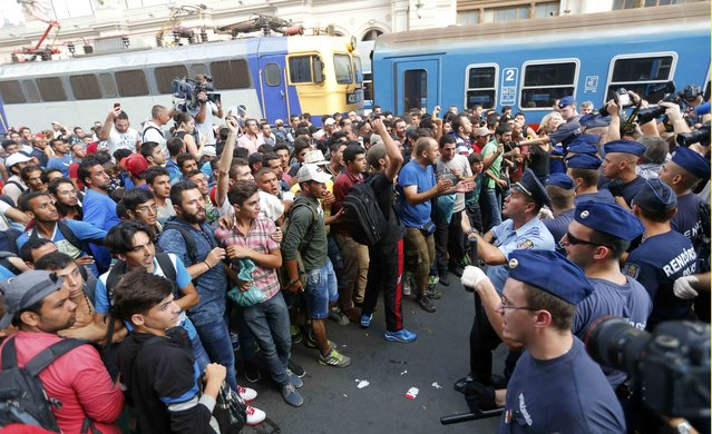 Migrants face Hungarian police in the main Eastern Railway station in Budapest, Hungary, September 1, 2015. (Photo by Laszlo Balogh/Reuters)