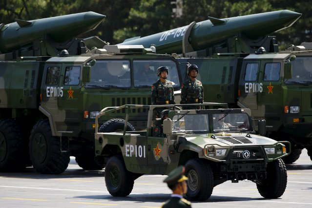 Military vehicles carry DF-15B short-range ballistic missiles during the military parade to mark the 70th Anniversary of the end of World War Two, in Beijing, China, September 3, 2015. (Photo by Damir Sagolj/Reuters)