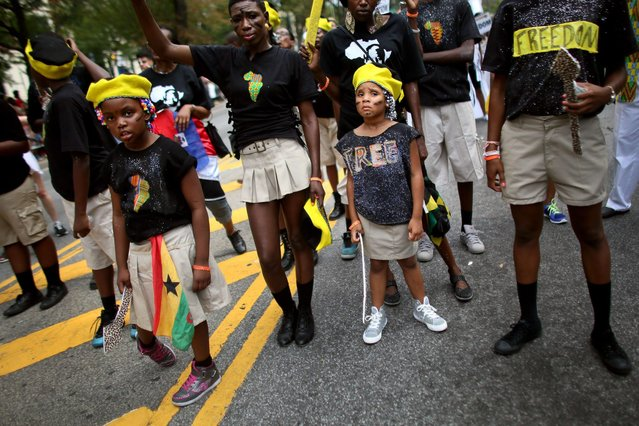 Revelers participate in the annual West Indian Day parade held on September 1, 2014 in the Brooklyn borough of New York City. The parade, which draws a crowd of a million plus, celebrates Caribbean culture. (Photo by Yana Paskova/Getty Images)