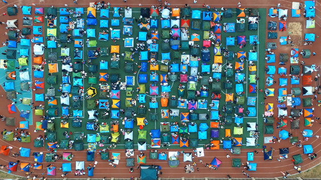 Aerial view of about 300 tents put up by elementary students and their parents on the playground on September 15, 2017 in Shijiazhuang, Hebei Province of China. A primary school in Shijiazhuang held the parent-child activities for their first-year students. (Photo by VCG/VCG via Getty Images)