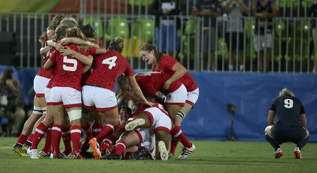 2016 Rio Olympics, Rugby, Women's Bronze Medal Match Canada vs Britain, Deodoro Stadium, Rio de Janeiro, Brazil on August 9, 2016. Canada celebrates their win over Britain. (Photo by Alessandro Bianchi/Reuters)
