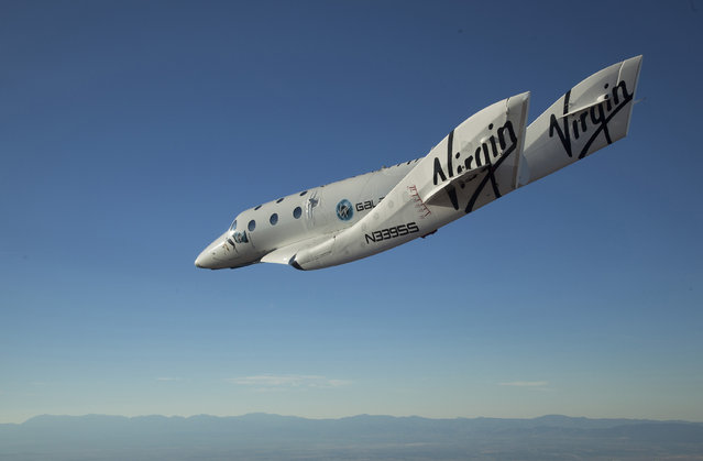The Virgin Galactic SpaceShip2 (VSS Enterprise) glides toward Earth on its first test flight after being released from its WhiteKnight2 mothership (VMS Eve) over  Mojave, California, October 10, 2010. (Photo by Mark Greenberg/Reuters/Virgin Galactic)